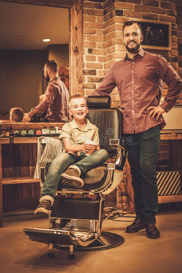 Stylish little boy and his father stock image