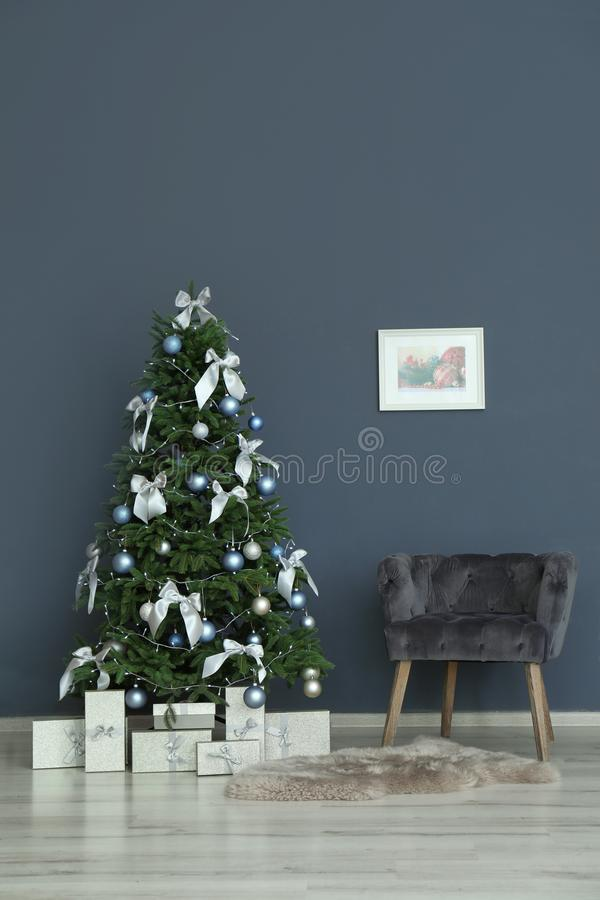 Stylish living room interior with decorated Christmas tree royalty free stock photography