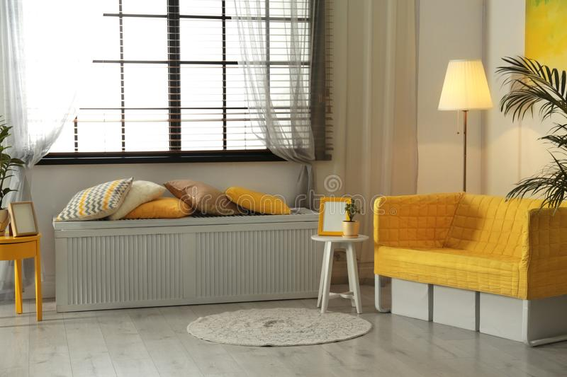 Stylish living room interior with modern furniture. Near window royalty free stock photography