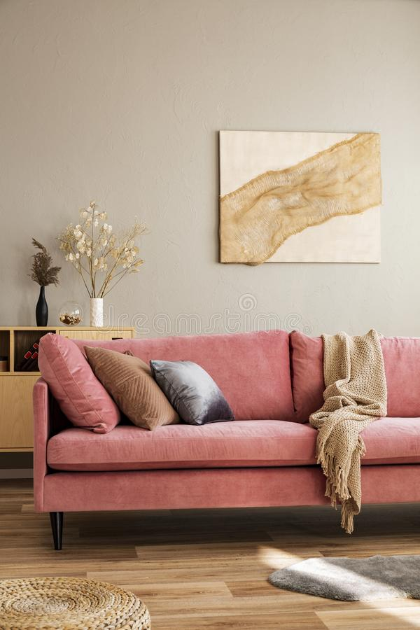 Stylish living room interior with pastel pink sofa, wooden coffee table and eco fireplace. Stylish living room interior with pastel pink sofa, wooden table and stock photography