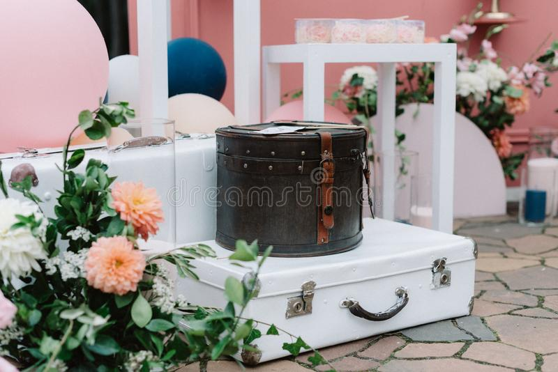 A stylish location for wedding photos decorated with retro suitcases, fresh flowers and original globes stock photos
