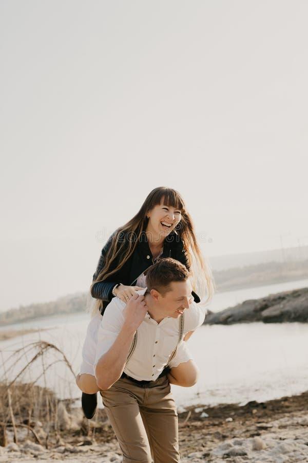 Stylish and loving couple enjoying each other stock image