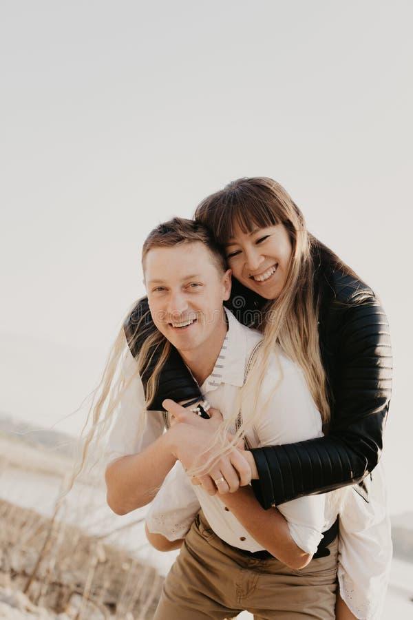 Stylish and loving couple enjoying each other stock photos