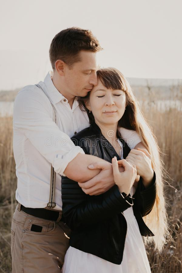 Stylish and loving couple enjoying each other outdoor- Image stock photos