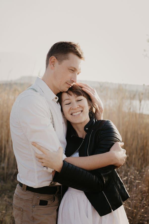 Stylish and loving couple enjoying each other outdoor- Image stock image