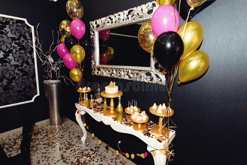 Stylish luxury decorated candy bat with balloons at the golden b stock images