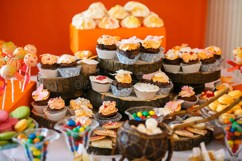 Stylish luxury decorated orange candy bar for the celebration of. A wedding of happy couple, cathering in the restaurant stock image