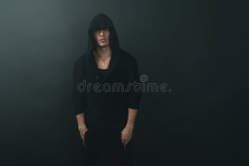 Stylish man in black hoodie. Stylish man in a black hoodie stock image