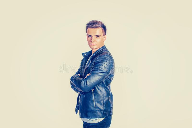 Stylish man in black leather jacket stock photo