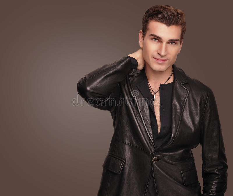 Stylish man in black suit. Fashion model. stock image