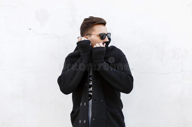 Stylish man in black sweater on white background. афыршщт stock image