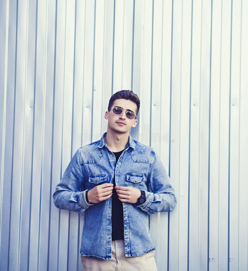 Stylish man in glasses and denim jacket royalty free stock image