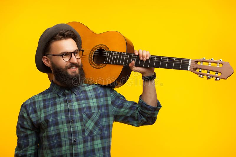 Stylish man with guitar in studio stock photos