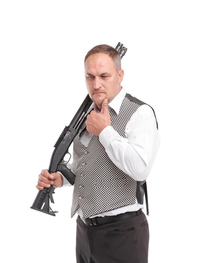 Stylish man with rifle. White background stock photos