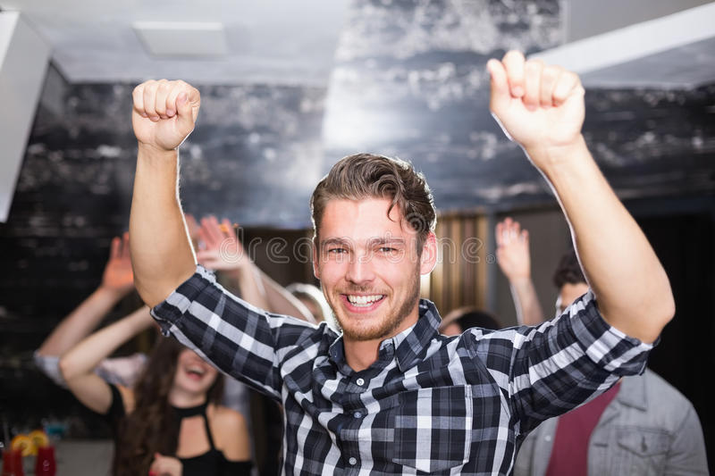 Stylish man smiling and dancing stock images