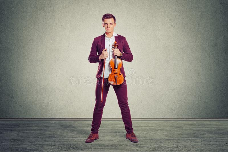 Stylish man in suit with violin stock image