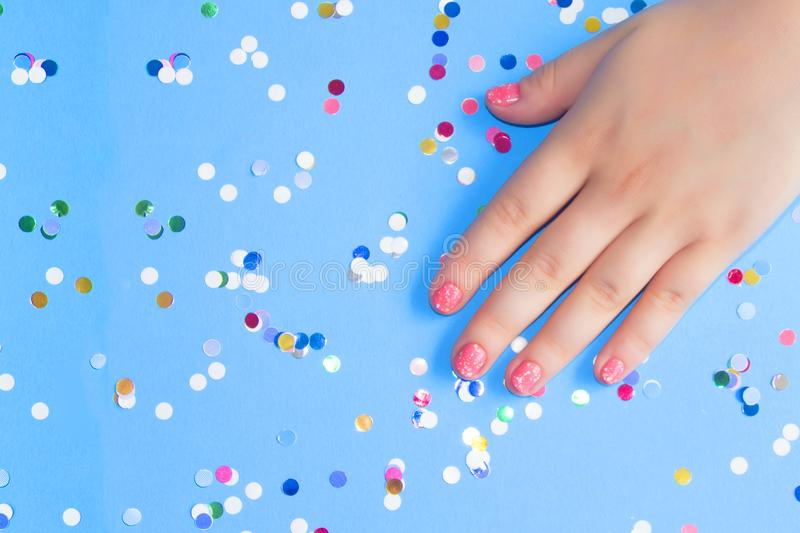 Stylish manicure of coral color nails royalty free stock photography