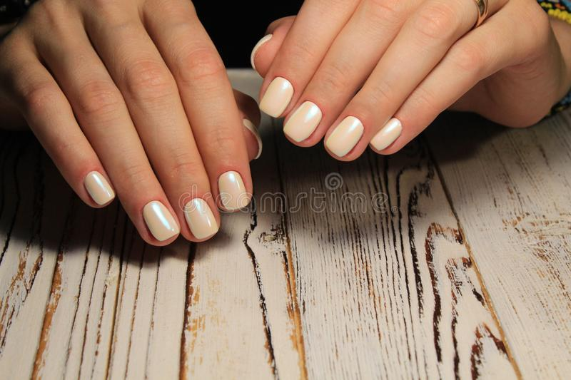 Stylish manicure nails color black and silver stock photography