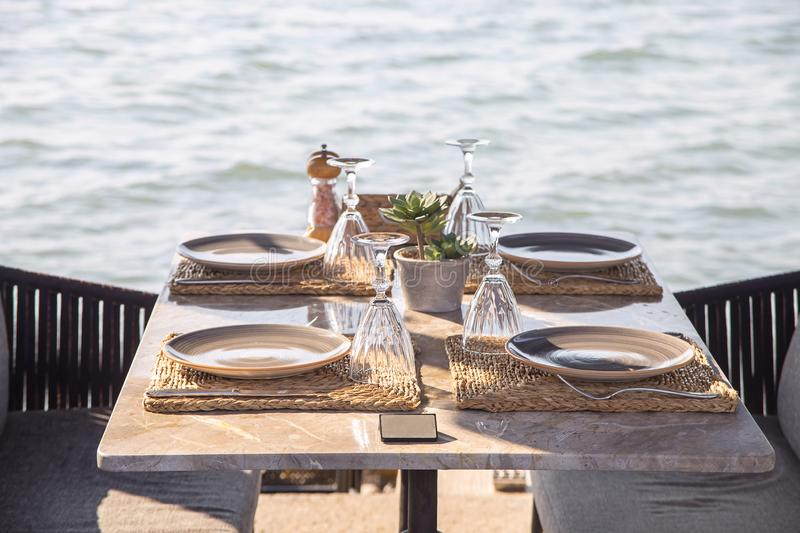 Travel table for lunch or dinner by the sea royalty free stock images