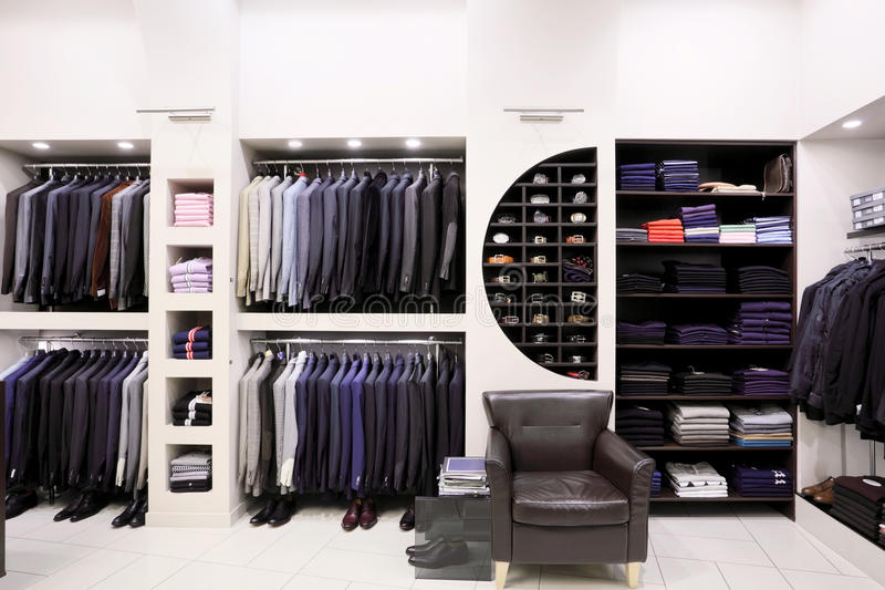 Stylish men's clothes in shop stock photos