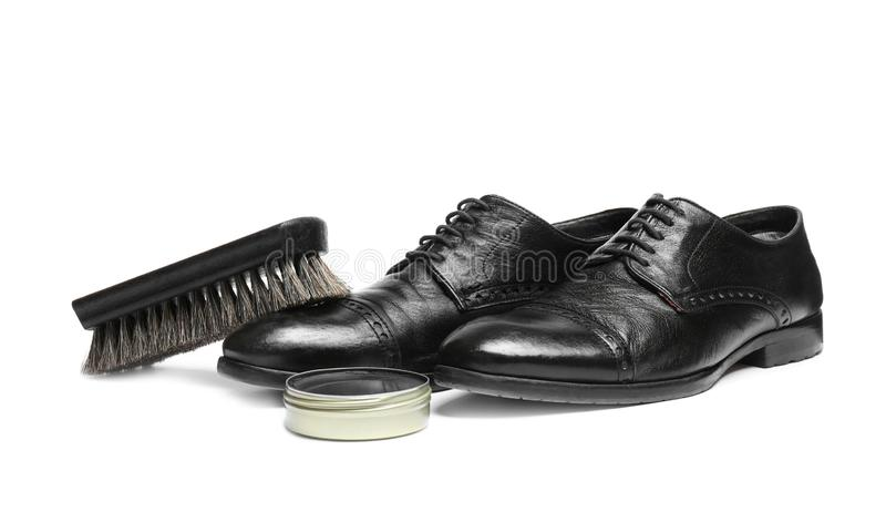 Stylish men`s footwear and shoe care accessories. On white background stock image