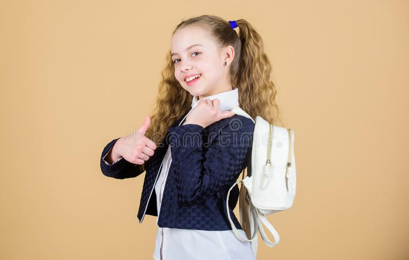 Stylish mini backpack. Girl little fashionable cutie carry backpack. Schoolgirl with small leather backpack. Carry bag. Comfortable. Popular useful fashion royalty free stock photography