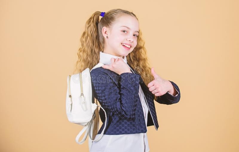 Stylish mini backpack. Girl little fashionable cutie carry backpack. Schoolgirl with small leather backpack. Carry bag. Comfortable. Popular useful fashion stock image