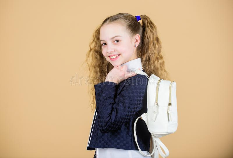 Stylish mini backpack. Learn how fit backpack correctly. Girl little fashionable cutie carry backpack. Schoolgirl with stock images