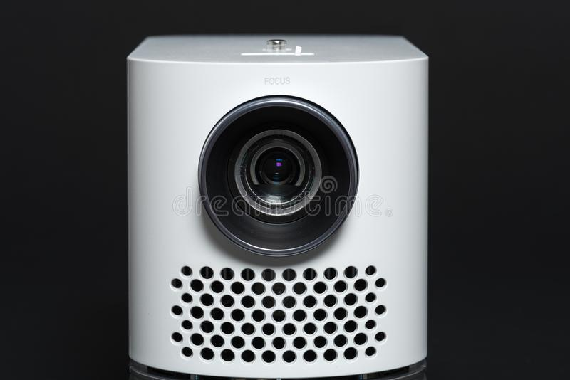 Stylish mini home cinema LED projector, lightweight tech gadget stock photography