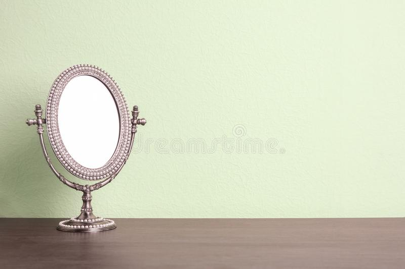 Stylish mirror on table royalty free stock photo