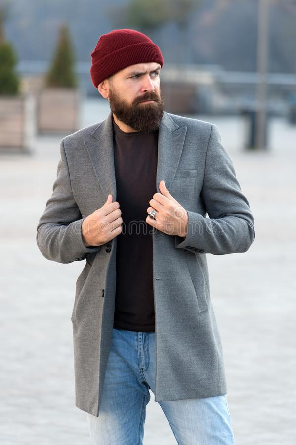 Stylish modern outfit hat bright accessory. Hipster outfit. Stylish casual outfit for fall and winter season. Menswear. And male fashion concept. Man bearded stock photo