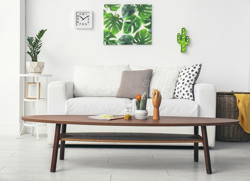 Stylish modern room interior with picture of tropical leaves stock image