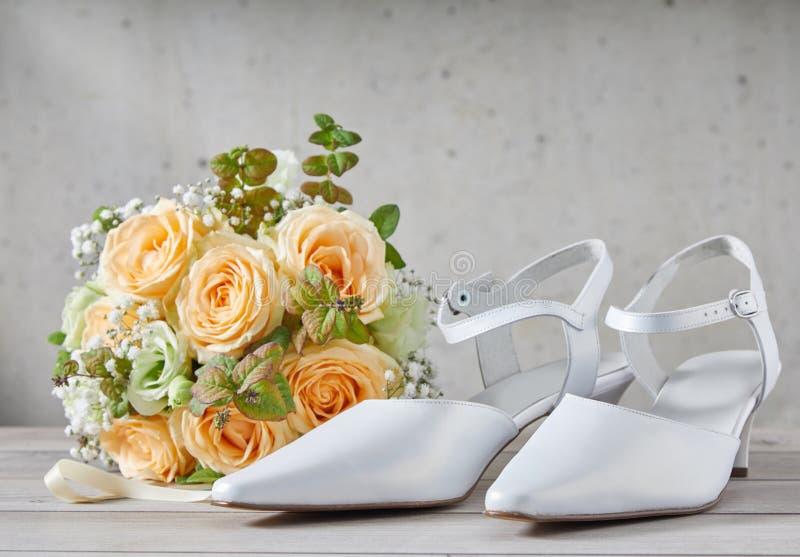 Stylish modern white pointed toe wedding shoes stock photo
