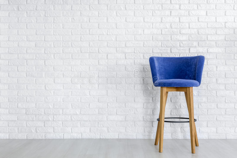 Stylish navy blue bar stool stock photography