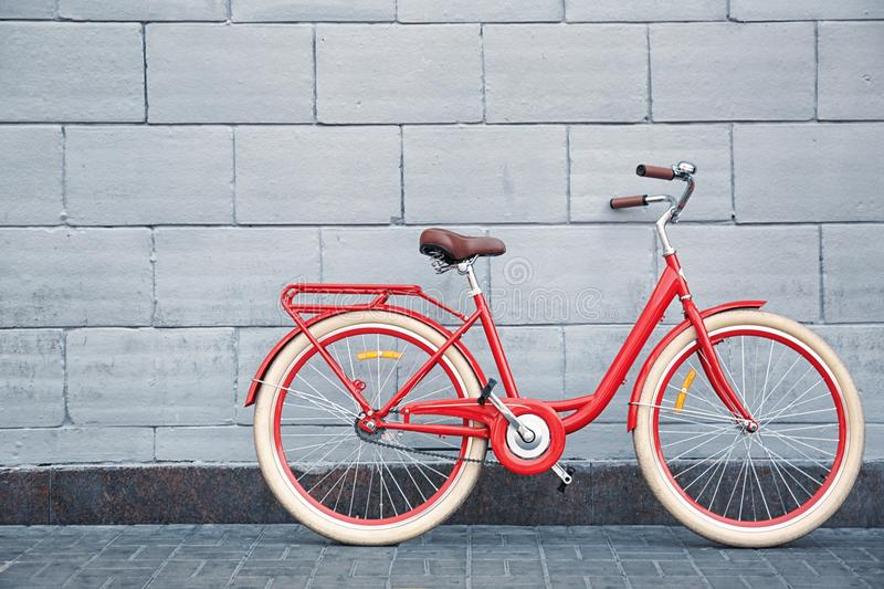Stylish new bicycle near stone outdoors royalty free stock photography