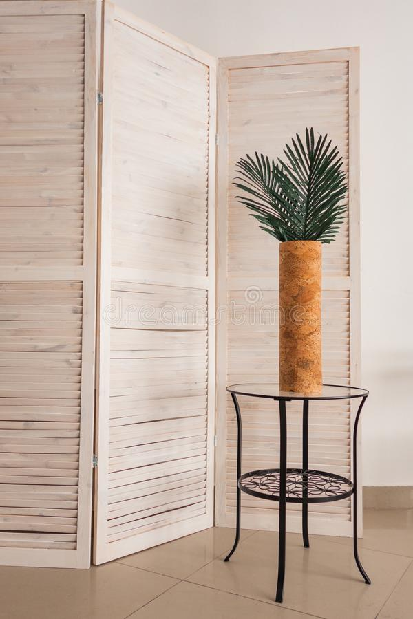 Stylish office decoration with tropical leaves. In a vase stock image