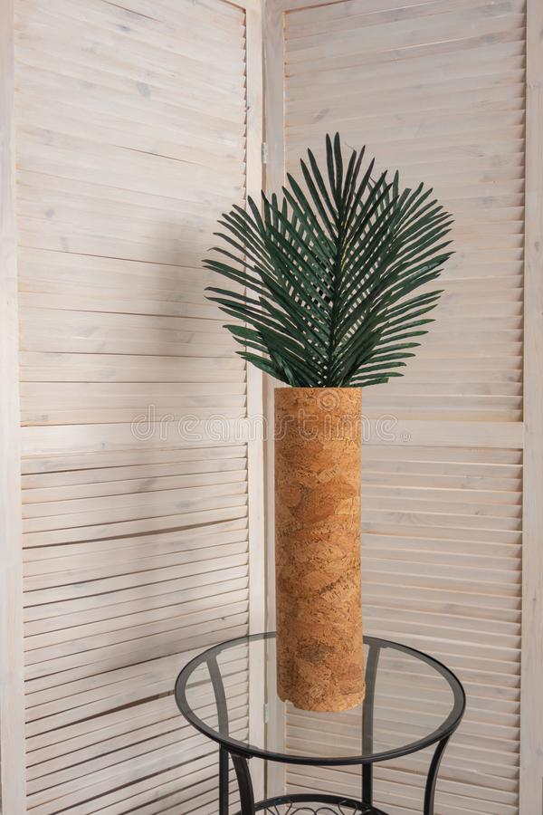 Stylish office decoration with tropical leaves. In a vase royalty free stock photo