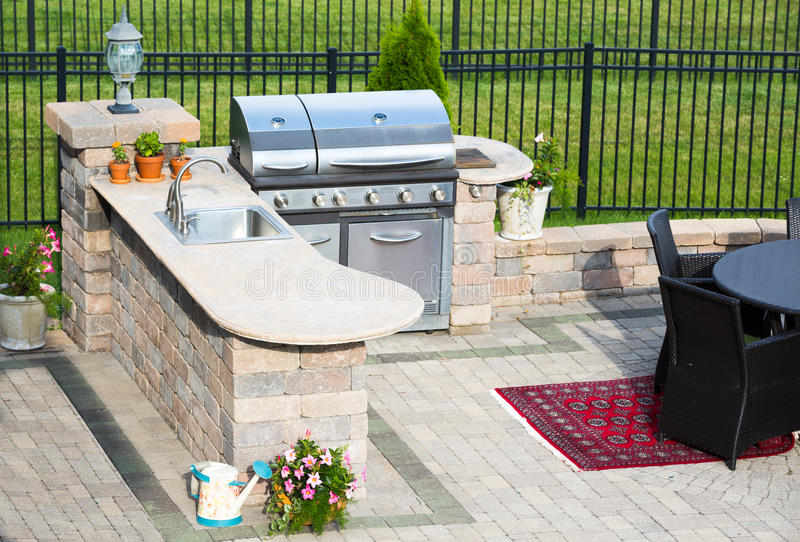 Stylish outdoor kitchen on a brick patio stock images