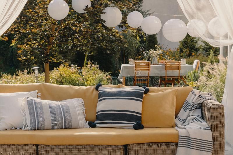 Stylish outdoor living room on the terrace of elegant house, real photo. Stylish outdoor living room on the terrace of elegant house stock images