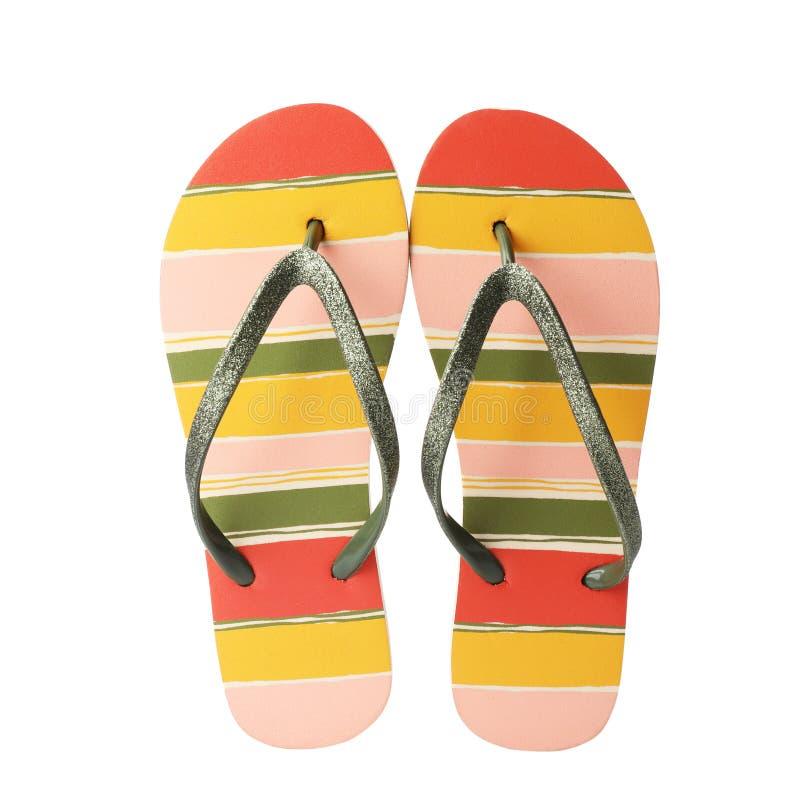 Stylish pair of flip flops on white background. Beach accessory stock image