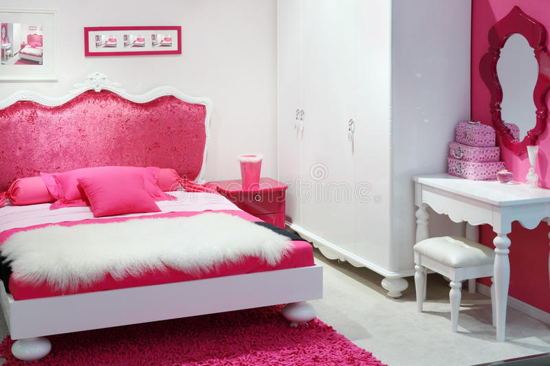 Stylish pink bedroom. With double bed, white wardrobe and mirror stock photos