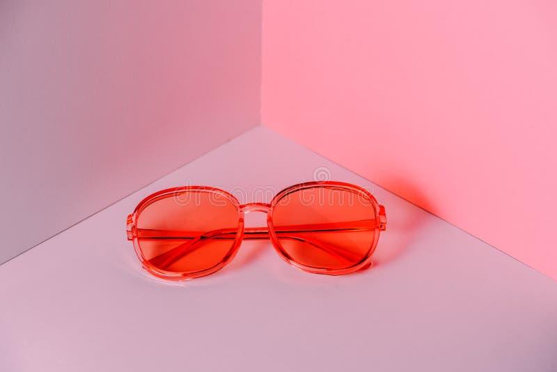 Stylish pink sunglasses on modern minimal background, front view. Nobody. Product photograph stock image