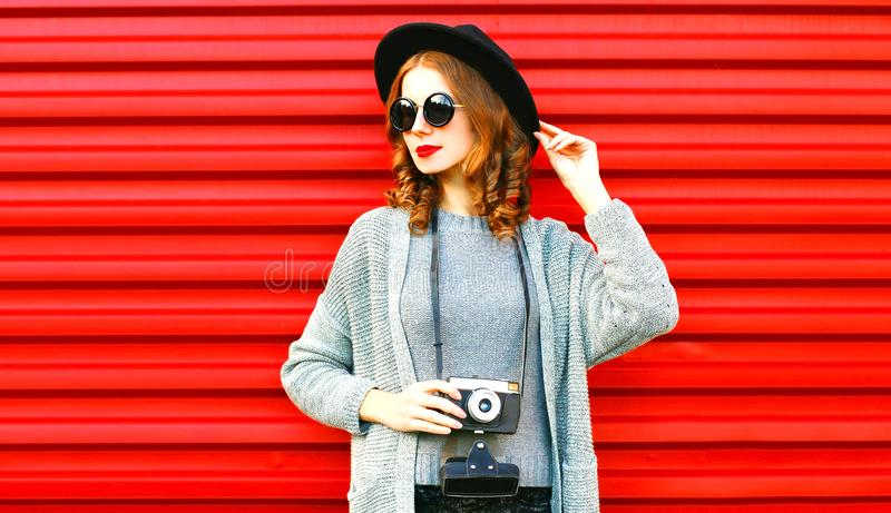 Stylish portrait autumn portrait woman holds retro camera royalty free stock image