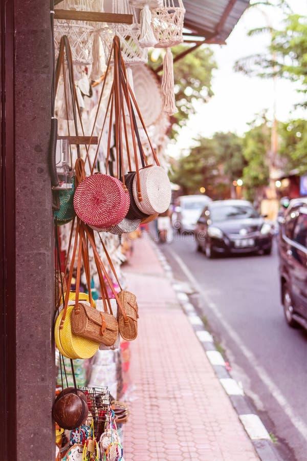 Stylish rattan handbags on the balinese street in Ubud. Bali island royalty free stock images