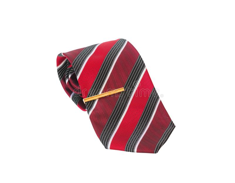 Stylish red striped rolled necktie and gold colored tie pin isolated on white royalty free stock photo