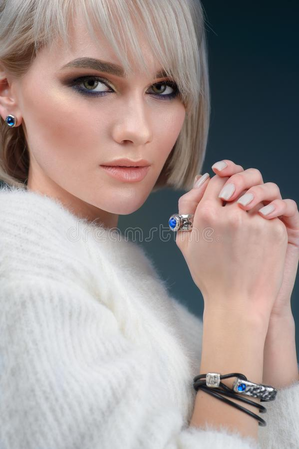 Stylish ring on girl finger. Fashion model  demonstrated collection luxury accessory and jewelry. The Stylish ring on girl finger. Fashion model  demonstrated royalty free stock photography