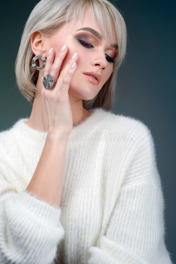 Stylish ring on girl finger. Fashion model woman demonstrated collection luxury accessory and jewelry. The Stylish ring on girl finger. Fashion model woman royalty free stock images