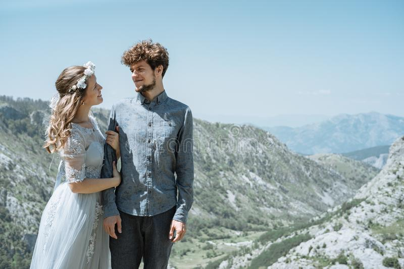 Stylish Romantic couple against the background of the mountains royalty free stock photos
