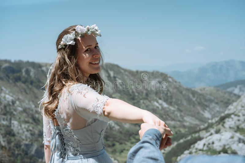 Stylish Romantic couple against the background of the mountains royalty free stock photography
