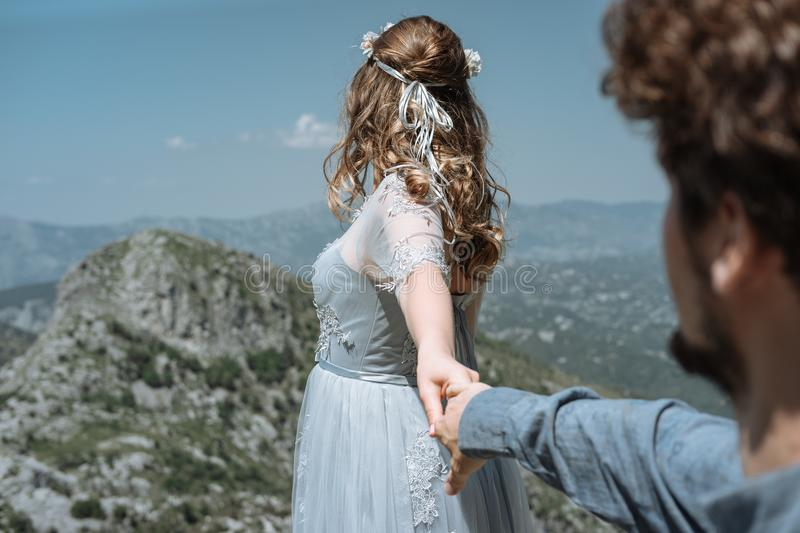Stylish Romantic couple against the background of the mountains royalty free stock images